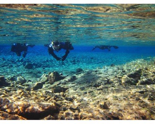 Snorkeling in sunken prison ruins in Rummu quarry